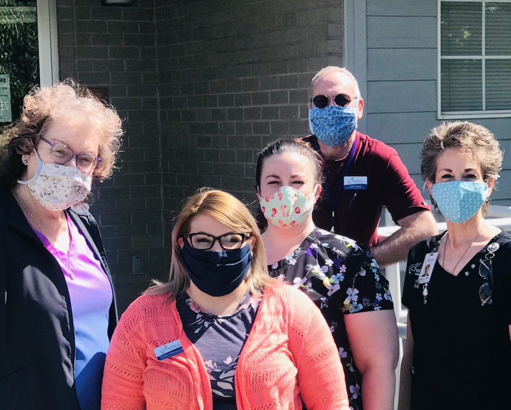 Chaplaincy Hospice House staff wearing hand-sewn masks donated by the community