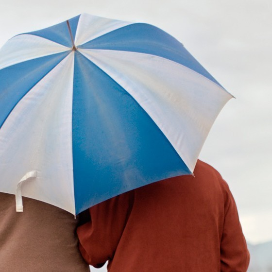 couple in rain e1459885088541 - Hospice, Palliative and Grief Care